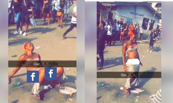 Lady strips off in the middle of a road in Mushin, Lagos lailasnews